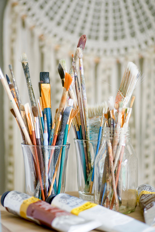 paintbrushes in cup